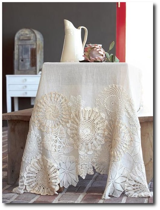 stitch-doilies-onto-linen-table-cloth-perfect-for-art-show-tables