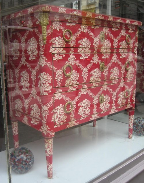 Neoclassical wallpapered neoclassical chest with brass hardware from