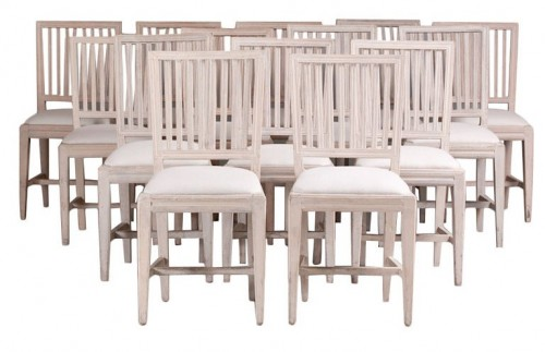 A Set of Fourteen Swedish Gustavian Dining Chairs
