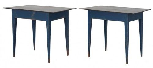 A pair of late Gustavian side tables with tapered legs. base painted in a dark blue and top in a matt black.