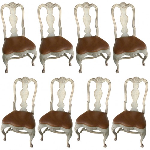 An extra ordinary set of 8 rarely seen Rococo dining Chairs. Frame and decorations are all original. Curved legs carved with rocailles and acanthus leaves standing on a claw-and-ball feet. Back splat with baluster shape.
