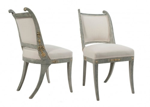 Pair of Gustavian Side Chairs in a worn pale blue patina and gilded metal details.