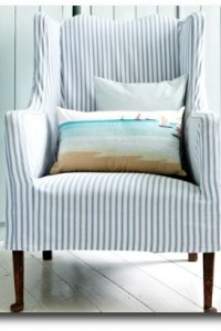 And a slipcovered chair with a summer feeling, photographed by Russel Sadur.