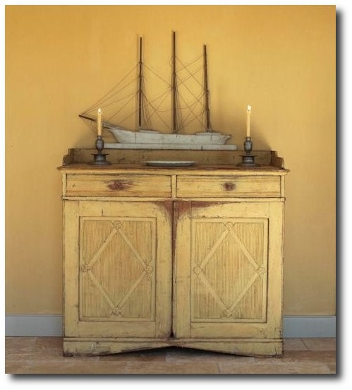 A-ship-Model-sits-on-top-of-a-Swedish-early-nineteenth-century-yellow-orche-Buffet-with-fluted-diamond-panels