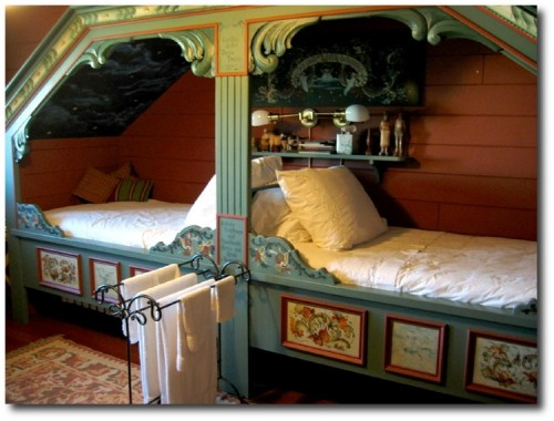 Norwegian cubbord beds adorned with wood carvings and Rosemaling