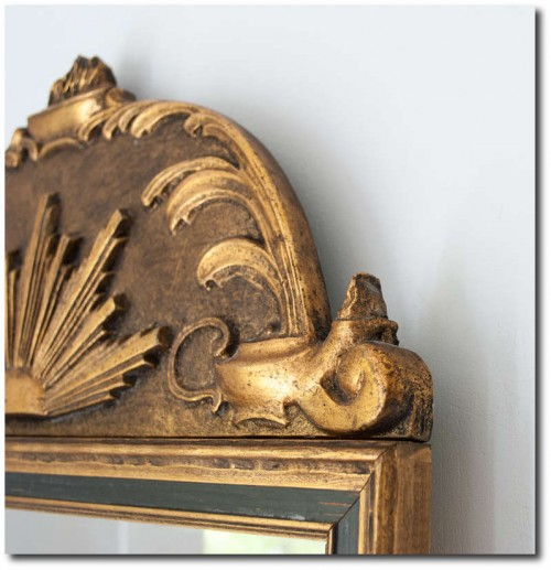 . Gilt wood Swedish Art Deco mirror with sunburst and oil lamp motif.