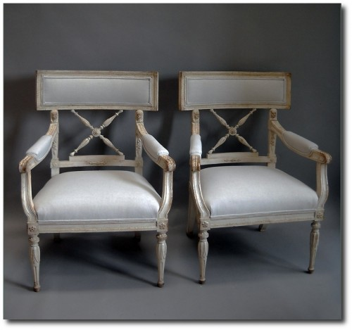 Pair of Swedish armchairs from the empire period, circa 1860, with upholstered seats and backs.