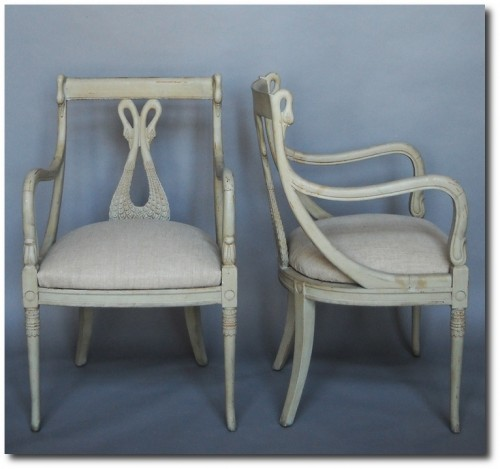 Pair of armchairs, Sweden circa 1860, with swan carved splats and gracefully curving arms with swan heads at the top.