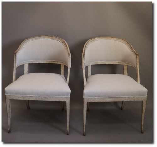 Pair of side chairs, Sweden circa 1880, with rounded form and saber legs.