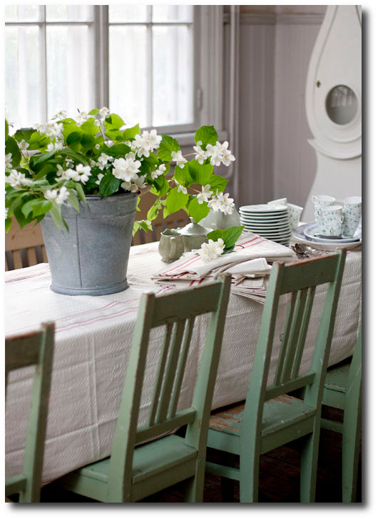 Swedish-Table-With-Green-Painted-Chairs