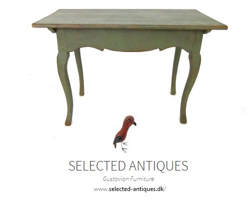 Swedish painted freestanding rococo table, with carved apron, circa 1750.