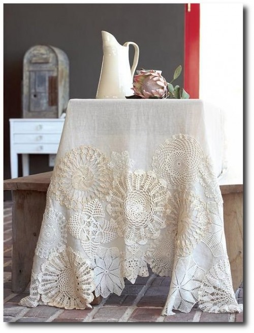 Stitch doilies onto linen and embellish it with buttons, ribbon, embroidery - Found on ideasmag.co.za