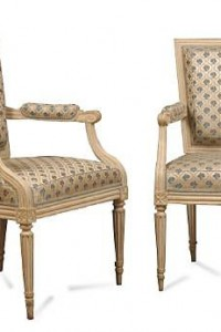 A pair of French 18th century Louis XVI cream-painted fauteuils