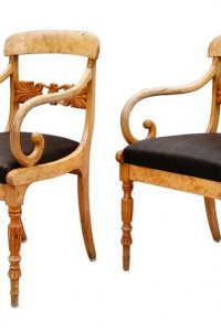 A pair of Swedish Biedermeier armchairs in light birch made during the mid 19th Century ca 1840.
